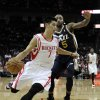 Houston Rockets\' Jeremy Lin (7) drives the ball past Utah Jazz\'s Mo Williams (5) in the first half of an NBA basketball game on Saturday, Dec. 1, 2012, in Houston. (AP Photo/Pat Sullivan)