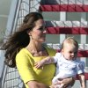 Britain\'s Kate, the Duchess of Cambridge, and Prince George arrive in Sydney, Australia, Wednesday, April 16, 2014. The Duke and Duchess of Cambridge are on a three-week tour of Australia and New Zealand, the first official trip overseas with their son, Prince George. (AP Photo/Rob Griffith)