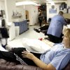 Jan Carter of Midland gives blood at the United Blood Services in Midland after a flatbed truck carrying wounded veterans and their families during a parade was struck by a train Thursday Nov. 15, 2012 00 in Midland, Texas. (AP Photo/James Durbin, Reporter-Telegram)
