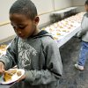 Daniel Carpenter, 9, and his sister Essence, 7, of Oklahoma City, enjoy free samples of soul food during a celebration of Black History and Culture at the Midwest City Public Library in Midwest City on Sunday, Feb. 15, 2009. By John Clanton, The Oklahoman