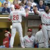 Photo - Philadelphia Phillies' Chase Utley is congratulated after hitting a home run during the first inning of a baseball game against the Milwaukee Brewers Wednesday, July 9, 2014, in Milwaukee. (AP Photo/Morry Gash)