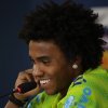 Photo - Brazil's Willian smiles during a press conference at the Granja Comary training center in Teresopolis, Brazil, Sunday, July 6, 2014.  Brazil will face Germany on Tuesday in their World Cup semifinals' match, without superstar soccer player Neymar. (AP Photo/Leo Correa)