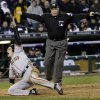 San Francisco Giants\' Ryan Theriot reacts after scoring from second on a hit by Marco Scutaro during the 10th inning of Game 4 of baseball\'s World Series against the Detroit Tigers Sunday, Oct. 28, 2012, in Detroit. (AP Photo/David J. Phillip)
