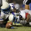 Millwood\'s Larry Lambeth, left, and Devin Dobbins fight for a loose ball during a high school football game against Star Spencer at Star Spencer in Oklahoma City, Friday, September 2, 2011. Millwood recovered the fumble. Photo by Bryan Terry, The Oklahoman