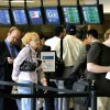 Passengers stand in line at the security checkpoint at Will Rogers World Airport in Oklahoma City Friday, August 24, 2007. BY PAUL B. SOUTHERLAND, The Oklahoman