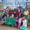 Oklahoma Baptist University students display an OBU flag at the New Day Orphanage in Mapanza, Zambia, during a summer Global Outreach trip. The OBU team included (from left to right) Timothy Thomsen, Dayla Rowland, Callie Neumeier, Brittany Sawyer, Joseph Hefner, Margo Thomason, Anna Nicanor and Hannah Burnett. Photo provided.