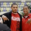 Austin Haywood, left, and teammate Julian Wilson pose for a picture before signing letters of intent with the University of Oklahoma. About a dozen Southmoore High School athletes signed letters of intent with colleges in and out of Oklahoma during a ceremony in the school\'s gymnasium Wednesday morning, Feb, 3, 2010. Photo by Jim Beckel, The Oklahoman