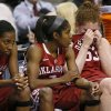 Oklahoma\'s Joanna McFarland (53), at right, wipes her eyes beside Aaryn Ellenberg (3) and Sharane Campbell (24), at left, during the Big 12 tournament women\'s college basketball game between the University of Oklahoma and Iowa State University at American Airlines Arena in Dallas, Sunday, March 10, 2012. Oklahoma lost 79-60. Photo by Bryan Terry, The Oklahoman