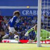Photo - Everton's Marouane Fellaini, centre, narrowly fails to score past West Bromwich Albion's Luke Daniels, right, as Jonas Olsson looks on during their English Premier League soccer match at Goodison Park Stadium, Liverpool, England, Saturday Aug. 24, 2013. (AP Photo/Jon Super)