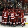 Photo - Detroit Red Wings players celebrate Henrik Zetterberg's goal in overtime against the Anaheim Ducks in Game 6 of a first-round NHL hockey Stanley Cup playoff series in Detroit, Friday, May 10, 2013. Detroit won 4-3. (AP Photo/Paul Sancya)