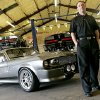 Jason Engel poses with his custom 1967 Mustang Fastback at Classic Recreations in Yukon, Okla., on Monday, March 24, 2008. The car is a copy of the car used in the movie