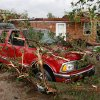 Tree branches cover cars in the driveway of a home on SH 74F near Cashion after a tornado raced across Logan County Tuesday afternoon, May 24, 2011, The home\'s roof was pulled away and more than a dozen trees on the property were knocked down. Photo by Jim Beckel, The Oklahoman