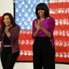 First lady Michelle Obama and Food Network chef Rachel Ray greet students at a