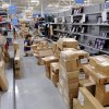 Photo -  Employees stock shelves as they prepare for the opening of Choctaw's first Walmart. Photo by Jim Beckel, The Oklahoman   Jim Beckel -