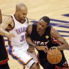 Miami\'s Mario Chalmers (15) drives past Oklahoma City\'s Derek Fisher (37) during Game 2 of the NBA Finals between the Oklahoma City Thunder and the Miami Heat at Chesapeake Energy Arena in Oklahoma City, Thursday, June 14, 2012. Photo by Chris Landsberger, The Oklahoman