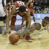 Michigan State\'s Branden Dawson (22) and Oklahoma\'s Jordan Woodard (10) fight for control of the ball during the second half of the championship game in the Coaches vs. Cancer NCAA college basketball game Sunday, Nov. 24, 2013, in New York. Michigan State won 87-76. (AP Photo/Frank Franklin II)