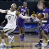 Photo - Baylor guard Odyssey Sims (0) reaches for the ball against TCU forward Chelsea Prince, right, as guard Zahna Medley (14) looks on during the first half of an NCAA college basketball game, Saturday, Jan. 11, 2014, in Waco, Texas. (AP Photo/LM Otero)