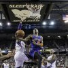 New York Knicks guard J.R.Smith, center, drives to the basket between Sacramento Kings\' Jason Thompson, left,and James Johnson, right, during the first quarter of an NBA basketball game in Sacramento, Calif., Friday, Dec. 28, 2012.(AP Photo/Rich Pedroncelli)