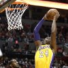 Los Angeles Lakers guard Kobe Bryant, right, goes to the basket over Portland Trail Blazers forward LaMarcus Aldridge during the first quarter of an NBA basketball game in Portland, Ore., Wednesday, Oct. 31, 2012. (AP Photo/Don Ryan)
