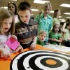 Photo - Grace Molloy, 8, and her brother Harrison Molloy, 9, of Norman watch beetles race at the Norman Public Library during a hands-on bug program Tues. March 17, 2009 in Norman, OK. BY JACONNA AGUIRRE, THE OKLAHOMAN. ORG XMIT: KOD