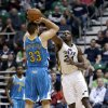 New Orleans Hornets\' Ryan Anderson (33) shoots as Utah Jazz\'s Paul Millsap (24) defends in the second quarter during an NBA basketball game Wednesday, Jan. 30, 2013, in Salt Lake City. (AP Photo/Rick Bowmer)