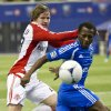 Montreal Impact\'s Sanna Nyassi, right, and Toronto FC\'s Terry Dunfield rush for the ball during the first half of an Amway Canadian Championship soccer match, Wednesday, May 2, 2012, in Montreal. (AP Photo/The Canadian Press, Paul Chiasson)