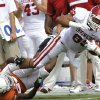 Oklahoma\'s Austin Haywood (89) is brought down by Texas\' Carrington Byndom (23) during the Red River Rivalry college football game between the University of Oklahoma Sooners (OU) and the University of Texas Longhorns (UT) at the Cotton Bowl in Dallas, Saturday, Oct. 8, 2011. Photo by Chris Landsberger, The Oklahoman