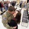 Above: Spc Adam Nicely, of Wagoner, is greeted with a kiss from his girlfriend, Shae Bellis, 20.