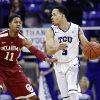 Photo - Oklahoma guard Isaiah Cousins defends as TCU guard Kyan Anderson controls the ball in the first half of an NCAA basketball game Saturday, March 8, 2014, in Fort Worth, Texas. Oklahoma won 97-67. (AP Photo/Sharon Ellman)