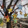 Hand-painted stars hang from a scorched tree among the ruins of houses in the Breezy Point section of New York, Thursday, Dec. 20, 2012. More than 100 homes were burned to the ground in an inferno that swept through the beachfront neighborhood during Superstorm Sandy on Oct. 29, 2012. The