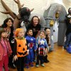 Teachers pose for a photo with their students from Nicoma Park Elementary School as a memory of their Halloween outing. Midwest City parks and recreation department hosted a trick or treat Halloween party for special needs children in the Nick Harroz Community Center Thursday afternoon, Oct. 31, 2013. A parks spokesperson said about 150 children, wearing costumes, attended the event. The children are students at local elementary schools. Students from Carl Albert Middle School Key Club volunteered at the carnival booths and they handed out candy and treats to the children as they entered the building. Photo by Jim Beckel, The Oklahoman.
