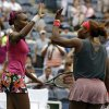Photo - Venus, left, and Serena Williams high five after beating Raquel Kops-Jones and Abigail Spears in a doubles match during the second round of the 2013 U.S. Open tennis tournament, Saturday, Aug. 31, 2013, in New York. (AP Photo/Mike Groll)