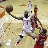 Houston Rockets\' James Harden (13) goes up for a layup as Los Angeles Clippers\' Blake Griffin (32) defends during the first quarter of an NBA basketball game Tuesday, Jan. 15, 2013, in Houston. (AP Photo/David J. Phillip)