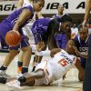 Oklahoma State\'s Toni Young passes the ball from under TCU\'s Veja Hamilton, left, Latricia Lovings, and Delisa Gross during a women\'s college basketball game between Oklahoma State University and TCU at Gallagher-Iba Arena in Stillwater, Okla., Tuesday, Feb. 5, 2013. Oklahoma State won 76-59. Photo by Bryan Terry, The Oklahoman