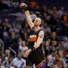 Phoenix Suns\' Marcin Gortat, of Poland, reacts after making a shot against the San Antonio Spurs during the first half of an NBA basketball game, Sunday, Feb. 24, 2013, in Phoenix. (AP Photo/Matt York)