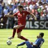 Photo - Spain's Javi Martinez (4) controls the ball as El Salvador's Keven Santamaria (8) defends during the first half of an exhibition soccer game, Saturday, June 7, 2014, in Landover, Md.. (AP Photo/Luis M. Alvarez)