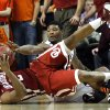 Oklahoma\'s Steven Pledger (2) and Oklahoma State\'s Marcus Smart (33) fight for a loose ball during the Bedlam men\'s college basketball game between the Oklahoma State University Cowboys and the University of Oklahoma Sooners at Gallagher-Iba Arena in Stillwater, Okla., Saturday, Feb. 16, 2013. Photo by Sarah Phipps, The Oklahoman