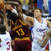 Photo -   Los Angeles Clippers forward Blake Griffin (32) and guard Chris Paul (3) defend Cleveland Cavaliers forward Tristan Thompson (13) during the first half of an NBA basketball game, Monday, Nov. 5, 2012, in Los Angeles. (AP Photo/Gus Ruelas)