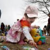 Sarah Harp, 2, gathers candy eggs at the city\'s annual Easter egg hunt at Andrews Park in Norman, Oklahoma on Friday, March 14, 2008. BY STEVE SISNEY, THE OKLAHOMAN