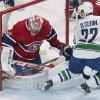 Photo - Montreal Canadiens goaltender Carey Price makes a save against Vancouver Canucks' Daniel Sedin during the second period of an NHL hockey game Thursday, Feb. 6, 2014, in Montreal. (AP Photo/The Canadian Press, Graham Hughes)