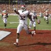 Oklahoma\'s Jamell Fleming (32) returns an interception for a touchdown during the Red River Rivalry college football game between the University of Oklahoma Sooners (OU) and the University of Texas Longhorns (UT) at the Cotton Bowl in Dallas, Saturday, Oct. 8, 2011. Photo by Bryan Terry, The Oklahoman