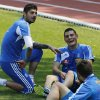 Greece\'s Kyriakos Papadopoulos, right, and goalkeeper Michalis Sifakis joke each other during a training session at the Euro 2012 soccer championship in Legionowo about 25 kilometers (15 miles) north of Warsaw, Poland on Monday, June 18, 2012. (AP Photo/Thanassis Stavrakis)