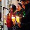 Jillian Soto, center, thanks the hundreds of people who came out to attend a candlelight vigil in memory of victims from the mass shooting in Newtown, Conn., which was held behind Stratford High School on the Town Hall Green in Stratford, Conn. on Saturday December 15, 2012. Jillian\'s sister Vicki, a Stratford native, was a teacher at Sandy Hook Elementary School and was one of the victims in the shooting. At left is sister Carly Soto and family friend Louis Sanchez. (AP Photo/The Connecticut Post, Christian Abraham) MANDATORY CREDIT