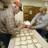 Volunteers Joe Gorman (left) and Vic Ward prepare sandwiches during