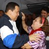 Photo -   In this photo provided by Miraflores Presidential Press Office, Venezuela's President Hugo Chavez, left, embraces his mother Helena Frias as she reaches to touch his forehead as she welcomes him home at the airport in Barinas, Venezuela, Wednesday April 4, 2012. Chavez returned to Venezuela on Wednesday night after his latest round of radiation therapy treatment in Cuba. (AP Photo/Miraflores Presidential Office)