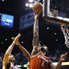 Milwaukee Bucks\' Larry Sanders (8) blocks the shot of Phoenix Suns\' Luis Scola (14), of Argentina, in the second half during an NBA basketball game on Thursday, Jan. 17, 2013, in Phoenix. The Bucks defeated the Suns 98-94. (AP Photo/Ross D. Franklin)