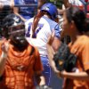 Photo - Florida designated player Lauren Haeger walks away dejected after striking out to end the inning while stranding three runners on base in the Women's College World Series elimination game versus Texas. The Longhorns would go on to win 3-0. Photo by KT KING, The Oklahoman