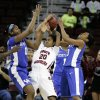 Kentucky\'s DeNesha Stallworth (11) and Bria Goss (13) force a turnover from South Carolina\'s Sancheon White (20) during the first half of their NCAA college basketball game, Thursday, Jan. 24, 2013, in Columbia, S.C. (AP Photo/Mary Ann Chastain)