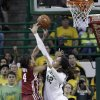 Oklahoma\'s Nicole Griffin (4) is fouled by Baylor\'s Brittney Griner (42) during the second half of an NCAA college basketball game Saturday, Jan. 26, 2013, in Waco Texas. Baylor won 82-65. (AP Photo/LM Otero) ORG XMIT: TXMO115