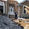 Charles Kellogg walks away from his destroyed house after severe weather hit the Eagle Point subdivision in Limestone County, Ala. on Friday, March 2, 2012. A reported tornado destroyed several houses in northern Alabama as storms threatened more twisters across the region Friday (AP Photo/The Decatur Daily, Jeronimo Nisa) ORG XMIT: ALDEC108